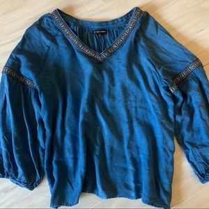 Women's blue and patterned blouse